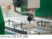Купить «Processing of metal parts with CNC machine at factory with lathes», фото № 28575380, снято 5 июня 2018 г. (c) Константин Шишкин / Фотобанк Лори