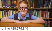 Купить «School girl in education library», фото № 28576840, снято 19 июня 2019 г. (c) Wavebreak Media / Фотобанк Лори