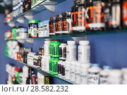 Купить «Shelves with sport nutrition in a sport food store indoor», фото № 28582232, снято 12 апреля 2018 г. (c) Яков Филимонов / Фотобанк Лори
