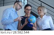 Купить «Three teachers discuss something with globe», фото № 28582544, снято 21 февраля 2019 г. (c) Vasily Alexandrovich Gronskiy / Фотобанк Лори