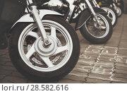 Купить «A sports bike is standing on the ground close up», фото № 28582616, снято 12 июня 2018 г. (c) Александр Сергеевич / Фотобанк Лори