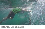 Купить «Underwater view of people snorkeling in Andaman Sea», видеоролик № 28585788, снято 3 июня 2018 г. (c) Игорь Жоров / Фотобанк Лори