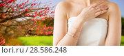 Купить «close up of beautiful woman with ring and bracelet», фото № 28586248, снято 9 апреля 2016 г. (c) Syda Productions / Фотобанк Лори