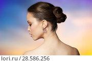 Купить «close up of beautiful woman face with earring», фото № 28586256, снято 9 апреля 2016 г. (c) Syda Productions / Фотобанк Лори