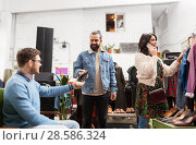 Купить «friends choosing clothes at vintage clothing store», фото № 28586324, снято 30 ноября 2017 г. (c) Syda Productions / Фотобанк Лори