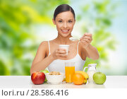 woman with fruits eating yogurt for breakfast. Стоковое фото, фотограф Syda Productions / Фотобанк Лори