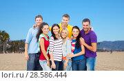 Купить «group of happy friends over venice beach», фото № 28586444, снято 31 августа 2013 г. (c) Syda Productions / Фотобанк Лори