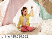 Купить «little girl with lantern in kids tent at home», фото № 28586532, снято 18 февраля 2018 г. (c) Syda Productions / Фотобанк Лори