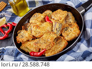 Купить «fried pieces of hake on a skillet», фото № 28588748, снято 4 июня 2018 г. (c) Oksana Zh / Фотобанк Лори