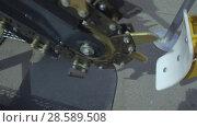 Купить «Trencher machine, a moving chain with many incisors», видеоролик № 28589508, снято 10 июня 2018 г. (c) Андрей Радченко / Фотобанк Лори