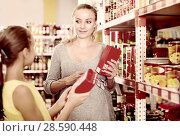 Купить «Woman with daughter are choosing fresh goods in food department», фото № 28590448, снято 5 июня 2017 г. (c) Яков Филимонов / Фотобанк Лори