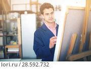 Купить «Artist painting on canvas», фото № 28592732, снято 8 апреля 2017 г. (c) Яков Филимонов / Фотобанк Лори