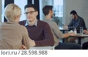 Купить «Young couple talking and drinking coffee near the window in cafe», фото № 28598988, снято 19 июня 2018 г. (c) Vasily Alexandrovich Gronskiy / Фотобанк Лори