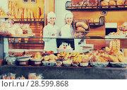Купить «Portrait of friendly pleasant women at bakery display», фото № 28599868, снято 18 июля 2018 г. (c) Яков Филимонов / Фотобанк Лори