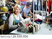 Купить «Two women sewing with professional equipment», фото № 28599956, снято 12 декабря 2018 г. (c) Яков Филимонов / Фотобанк Лори