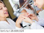 Купить «Woman doing manicure», фото № 28600024, снято 2 ноября 2016 г. (c) Яков Филимонов / Фотобанк Лори