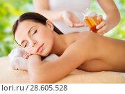 Купить «close up of beautiful woman having massage at spa», фото № 28605528, снято 25 июля 2013 г. (c) Syda Productions / Фотобанк Лори