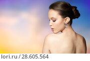 Купить «close up of beautiful woman face with earring», фото № 28605564, снято 9 апреля 2016 г. (c) Syda Productions / Фотобанк Лори