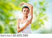 Купить «beautiful woman touching her armpit by feather», фото № 28605580, снято 9 апреля 2017 г. (c) Syda Productions / Фотобанк Лори