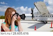 Купить «tourist woman photographing by camera over plane», фото № 28605616, снято 25 июля 2015 г. (c) Syda Productions / Фотобанк Лори