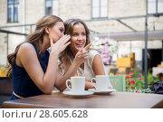 Купить «smiling young women drinking coffee and gossiping», фото № 28605628, снято 9 августа 2015 г. (c) Syda Productions / Фотобанк Лори