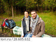 Купить «happy couple hugging at camp in woods», фото № 28605632, снято 27 сентября 2015 г. (c) Syda Productions / Фотобанк Лори