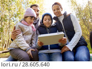 Купить «family sitting on bench with tablet pc at camp», фото № 28605640, снято 27 сентября 2015 г. (c) Syda Productions / Фотобанк Лори