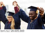 Купить «happy students celebrating graduation», фото № 28605660, снято 24 сентября 2016 г. (c) Syda Productions / Фотобанк Лори