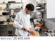 Купить «happy male chef cooking food at restaurant kitchen», фото № 28605664, снято 2 апреля 2017 г. (c) Syda Productions / Фотобанк Лори