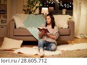 Купить «happy young woman reading book at home», фото № 28605712, снято 13 января 2018 г. (c) Syda Productions / Фотобанк Лори