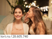 happy female friends gossiping at home. Стоковое фото, фотограф Syda Productions / Фотобанк Лори