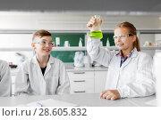 Купить «kids with test tubes studying chemistry at school», фото № 28605832, снято 19 мая 2018 г. (c) Syda Productions / Фотобанк Лори