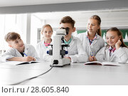 Купить «kids or students with microscope biology at school», фото № 28605840, снято 19 мая 2018 г. (c) Syda Productions / Фотобанк Лори