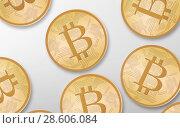 Купить «gold bitcoins over white background from top», фото № 28606084, снято 16 июля 2018 г. (c) Syda Productions / Фотобанк Лори