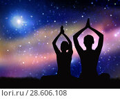 black silhouette of couple meditating over space. Стоковое фото, фотограф Syda Productions / Фотобанк Лори