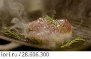 Купить «Steak Fried On A Grill With Rosemary», видеоролик № 28606300, снято 29 мая 2018 г. (c) Pavel Biryukov / Фотобанк Лори
