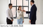 Купить «realtor giving key to customers at new office», видеоролик № 28606568, снято 12 июня 2018 г. (c) Syda Productions / Фотобанк Лори