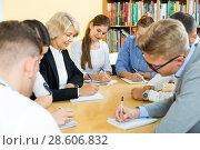 Купить «Happy students studying in classroom», фото № 28606832, снято 5 октября 2017 г. (c) Яков Филимонов / Фотобанк Лори