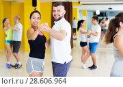 Купить «Smiling people dancing waltz», фото № 28606964, снято 21 июня 2017 г. (c) Яков Филимонов / Фотобанк Лори