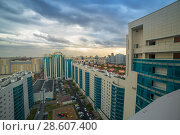 Купить «New modern rise apartment complex. The views from the apartment to the yard. Astana, Kazakhstan.», фото № 28607400, снято 27 июня 2019 г. (c) Владимир Пойлов / Фотобанк Лори