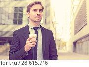 Купить «Portrait of cheerful male standing outdoor», фото № 28615716, снято 29 апреля 2017 г. (c) Яков Филимонов / Фотобанк Лори