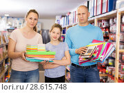 Купить «parents with daughter buying school supplies», фото № 28615748, снято 6 апреля 2018 г. (c) Яков Филимонов / Фотобанк Лори