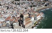 Купить «Video of aerial view of mediterranean resort town Sitges, Spain», видеоролик № 28622264, снято 27 апреля 2018 г. (c) Яков Филимонов / Фотобанк Лори
