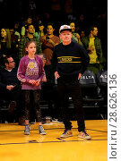 Купить «Celebrities at the Los Angeles Lakers game. The Golden State Warriors defeated the Los Angeles Lakers by the final score of 109-85 at the Staples Center...», фото № 28626136, снято 25 ноября 2016 г. (c) age Fotostock / Фотобанк Лори