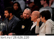 Купить «Celebrities at the Los Angeles Lakers game. The Golden State Warriors defeated the Los Angeles Lakers by the final score of 109-85 at the Staples Center...», фото № 28626220, снято 25 ноября 2016 г. (c) age Fotostock / Фотобанк Лори