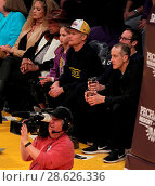 Купить «Celebrities at the Los Angeles Lakers game. The Golden State Warriors defeated the Los Angeles Lakers by the final score of 109-85 at the Staples Center...», фото № 28626336, снято 25 ноября 2016 г. (c) age Fotostock / Фотобанк Лори