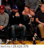 Купить «Celebrities at the Los Angeles Lakers game. The Golden State Warriors defeated the Los Angeles Lakers by the final score of 109-85 at the Staples Center...», фото № 28626376, снято 25 ноября 2016 г. (c) age Fotostock / Фотобанк Лори
