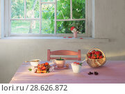 Купить «breakfast with strawberries on pink wooden table», фото № 28626872, снято 20 июня 2018 г. (c) Майя Крученкова / Фотобанк Лори