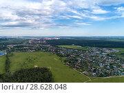 Купить «Aerial view of wheat fields, meadow, forest and village in rural Russia.», фото № 28628048, снято 11 июня 2018 г. (c) Андрей Радченко / Фотобанк Лори