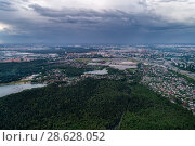 Купить «Aerial view of wheat fields, meadow, forest and village in rural Russia.», фото № 28628052, снято 11 июня 2018 г. (c) Андрей Радченко / Фотобанк Лори